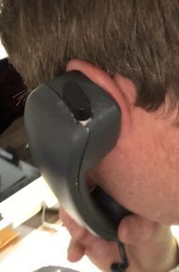 Hearing Aid Handset on Ear